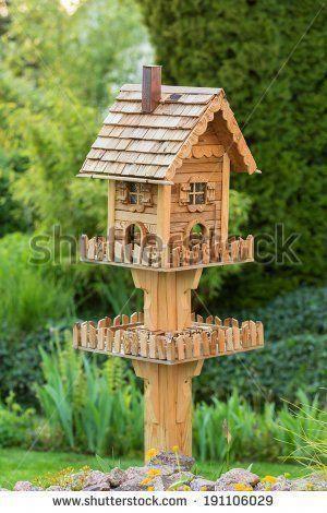 Homemade bird house next to a pond in the backyard #buildaviary