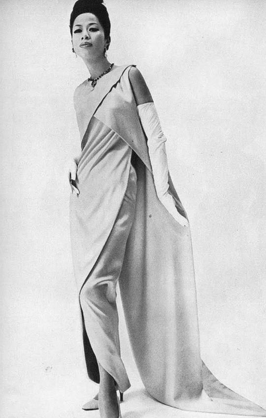 1965 Balenciaga's beautifully fluid, brilliantly colored Chinese yellow satin crepe, photo by William Klein for British Vogue