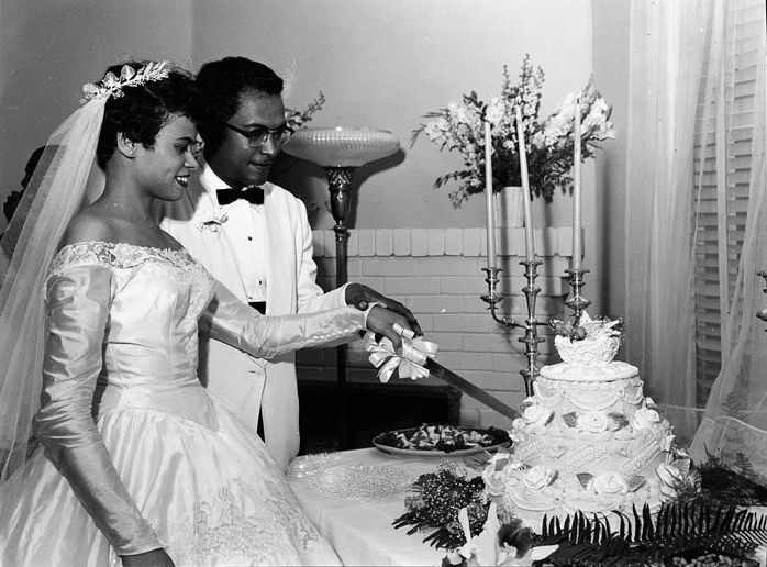 Slicing the cake, another shot from Miss Gloria Smith's wedding album, June 1956 Washington, D.C.  Photo by Addison Scurlock.  Source: vintagebrides.tumblr