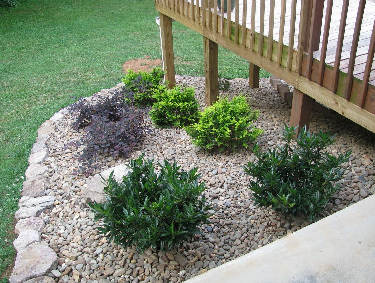 Landscaping around deck stairs home design ideas for Images of garden decking