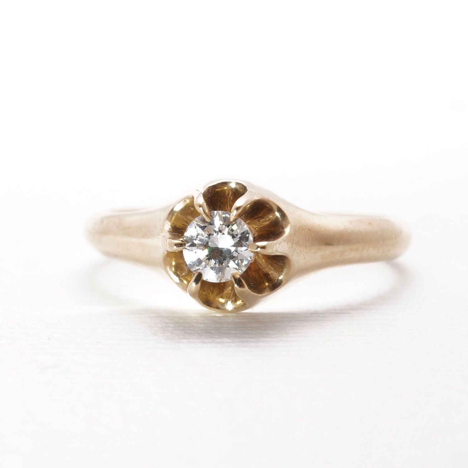 A personal favorite from my Etsy shop https://www.etsy.com/listing/250712061/vintage-engagement-ring-diamond-belcher