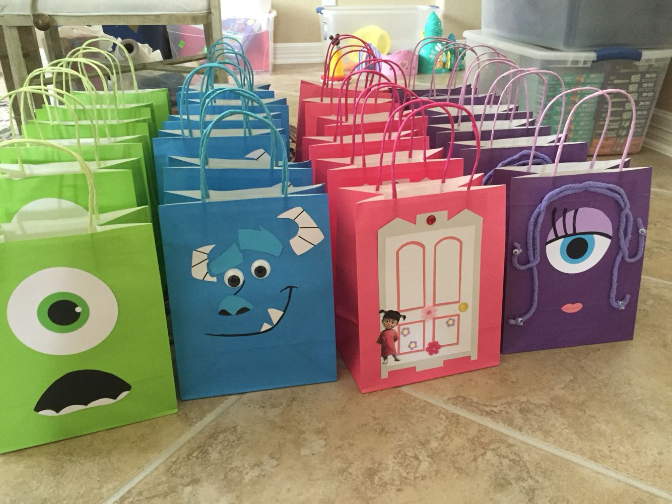 Diy party favor bags featuring boo and her door sulley