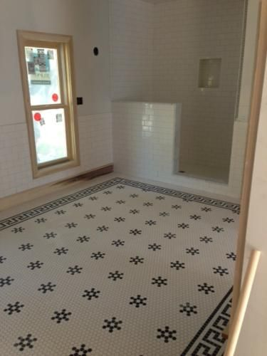 beautiful bathroom created with merola tile metro hex glossy white with black snowflake and metro greek - Bathroom Tile Floor Patterns