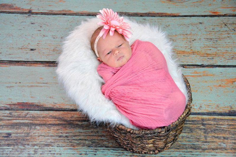 Turn your studio space into a rustic setting for your next newborn photography session.   Featured: Teal Pine Floordrop from Backdrop Express, Courtesy of Allyson Carter Digital Creations