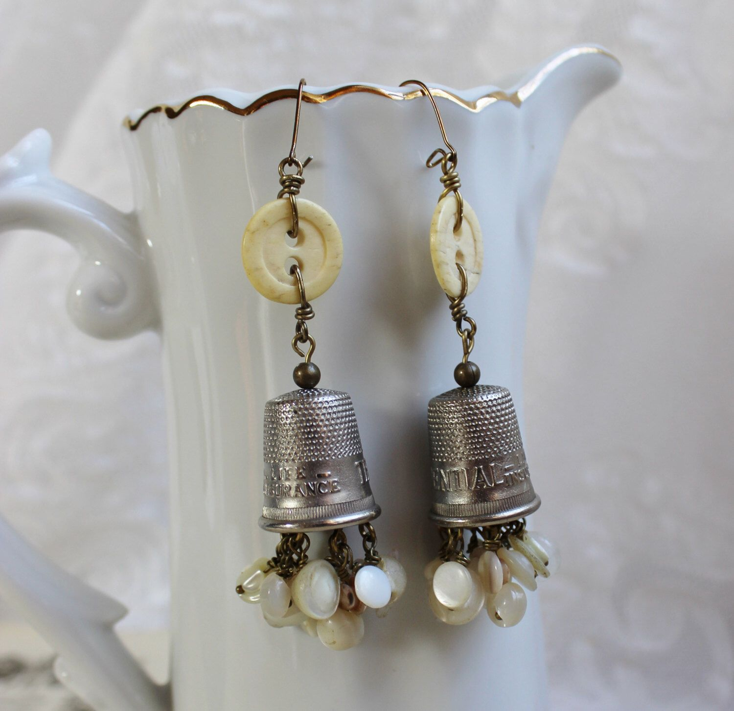 A thimble full antique thimble and button earrings