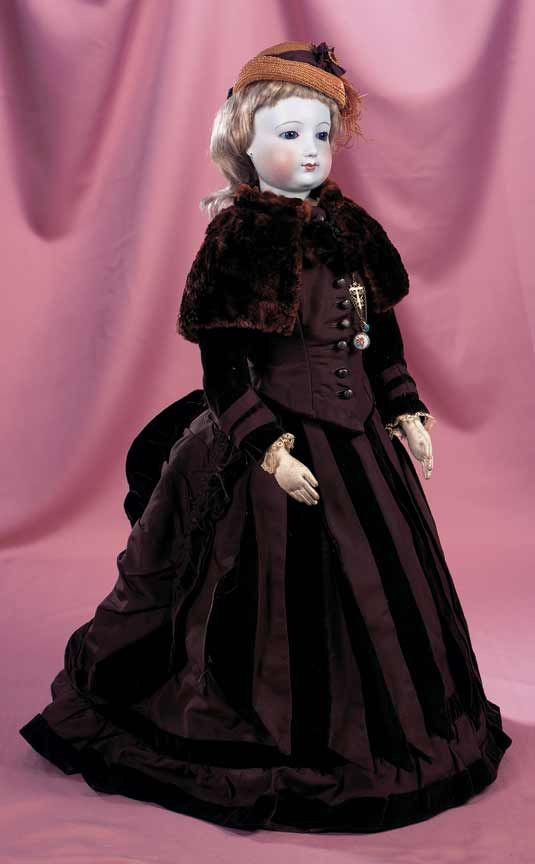 Doll attributed to Blampoix,circa 1860, 64 cm. Beautiful face and complexion on the large early poupee with swivel head,superb antique brown taffeta and velvet costume with fur cape,straw bonnet,undergarments,stockings,shoes,and wonderful chatelaine with watch and turquoise beads.