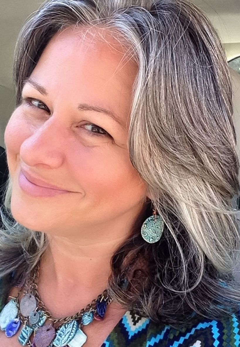 Grey hair. Natural grey hair and going gray. Beautiful woman with ...