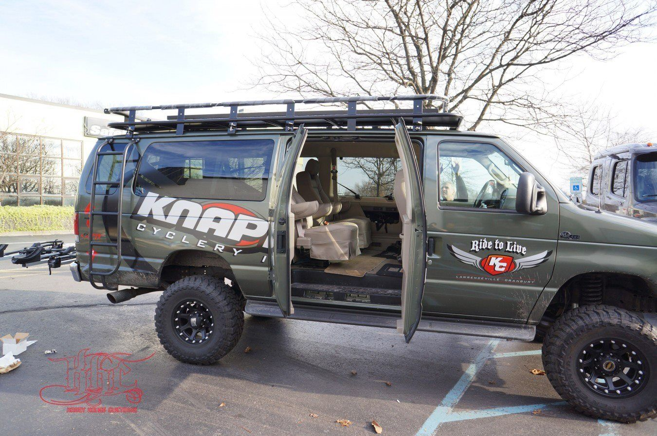 Lifted Ford Van With Aluminess Front And Rear Bumper Ladder And