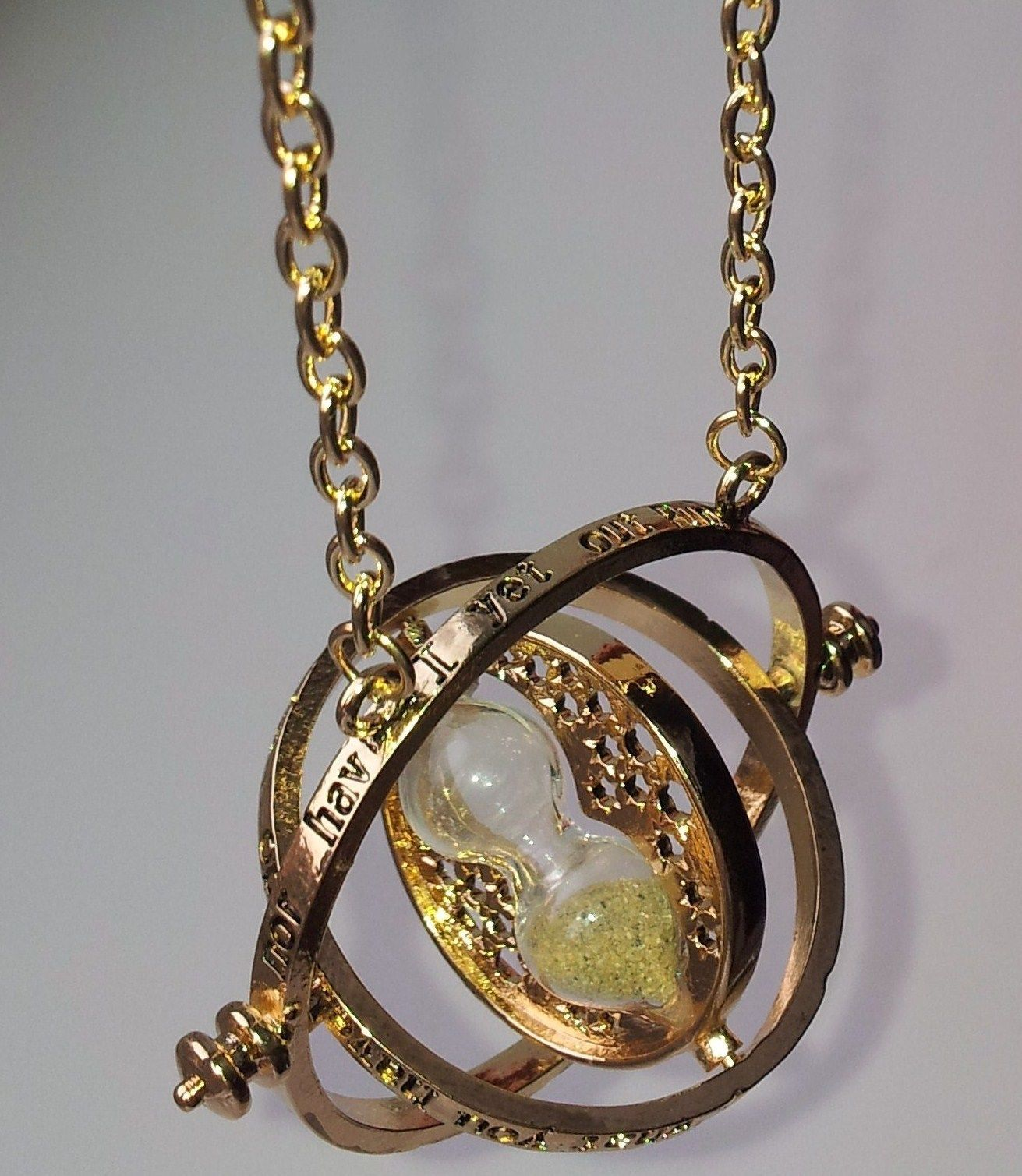 Beautiful gold timeturner necklace hermione granger