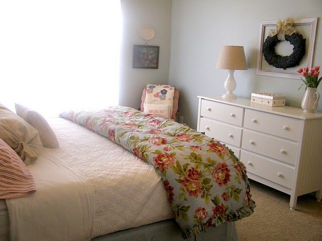 I really like how to dresser faces the bed, and the little lamp and old painted picture frame