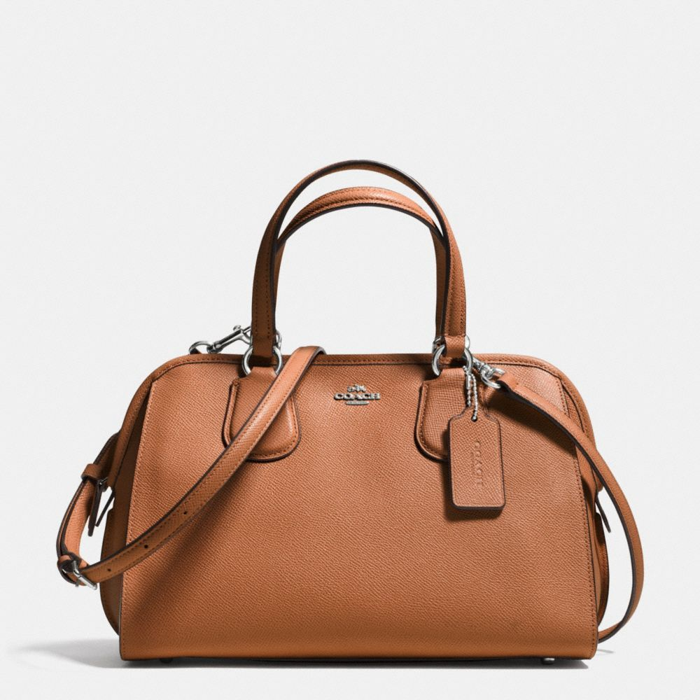 Crossgrain leather adds subtle texture to a softly structured satchel with a long strap for shoulder or crossbody wear. Perfectly organized inside, it has bound leather edges, minimalist hardware and tabbed handles reminiscent of archival Coach designs.