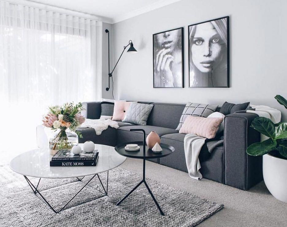 Light On The Wall Light Grey And Blush Pink Pillows White Round Coffee Table With G Grey Sofa Living Room Gray Living Room Design Living Room Decor Apartment