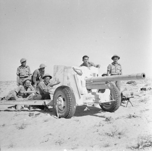 A 6-pdr anti-tank gun and its crew in action in the Western Desert, 3 November 1942.