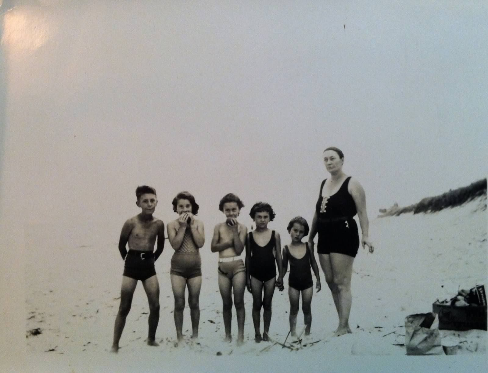 A mother with her bathing beauties and their brother.  Palm Beach, Florida. Circa 1934.