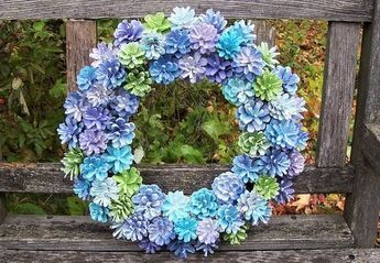 Pine Cone Wreath, Hydrangea-inspired. Unique wreath with painted Pine cones in purples, blues, white, and green.