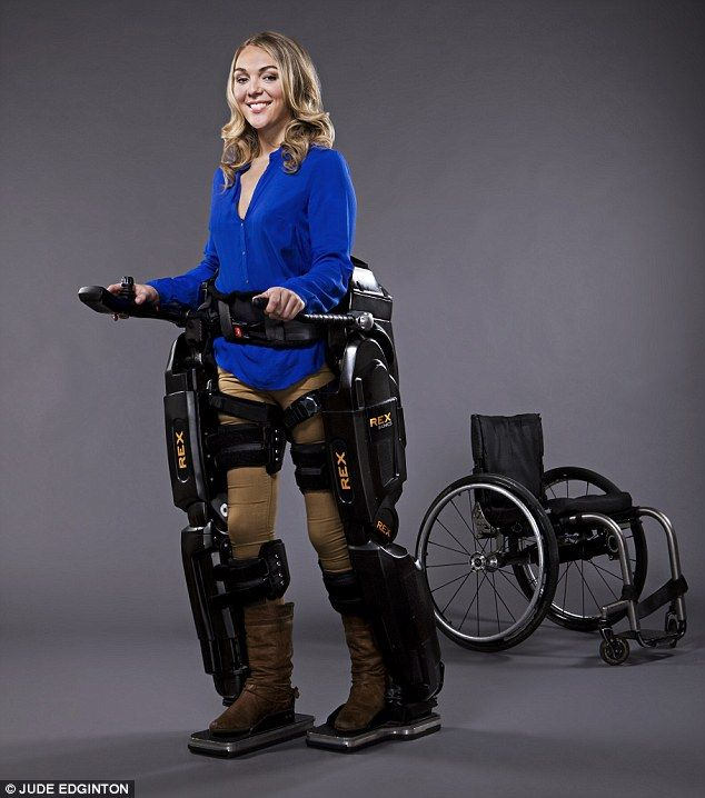 """The 90,000 'robolegs' that got me out of my wheelchair"": How one woman stood on her own feet nine years after she was paralysed    Positive step: Sophie in the robotic exoskeleton Rex, with her wheelchair in the background"