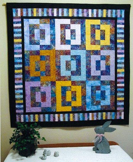 When I saw Batik Magic in the May/June 2010   issue of Love of Quilting,   I knew it was the perfect pattern for some batik fabric purchased when my   husband and I vacationed at a beautiful spot in Florida last year. I made it   as a wall quilt for our foyer and it was fun and easy to put together. Thanks   for a great pattern for a quilt I call, Amelia   Island Magic.
