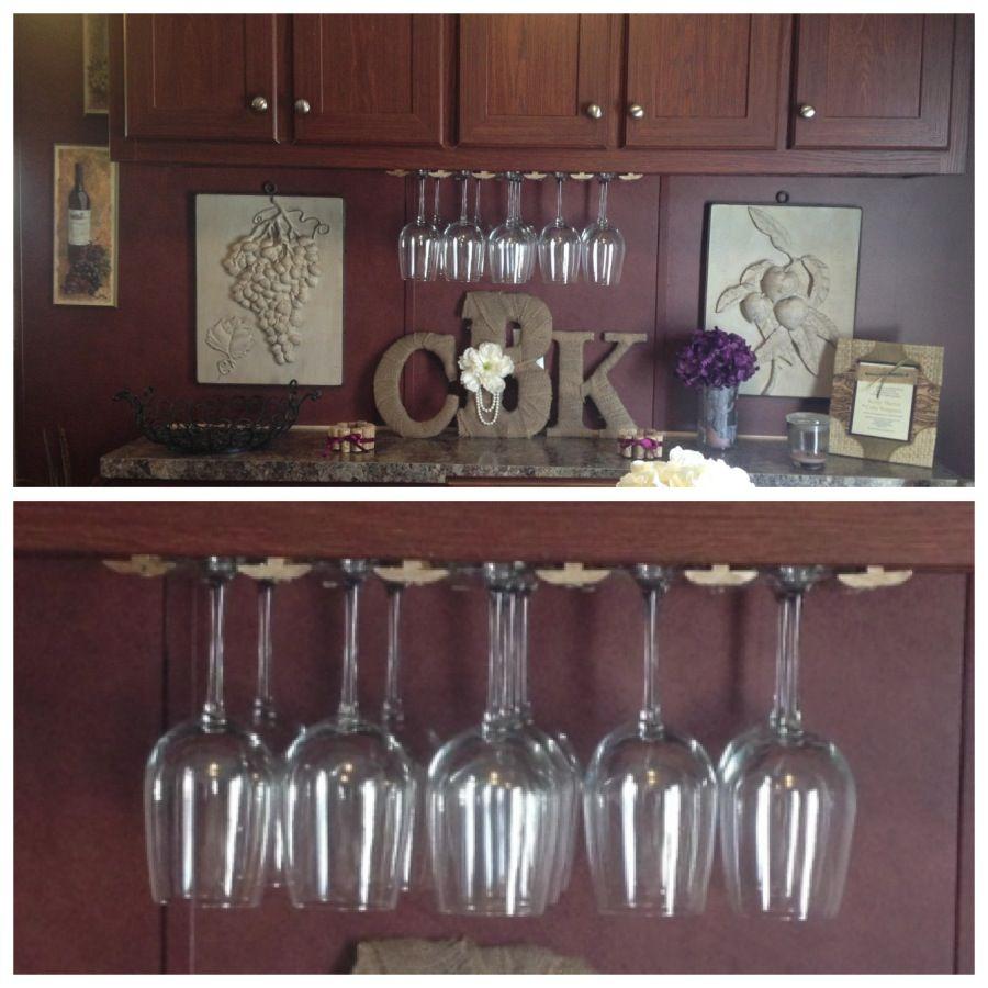 Wine Theme kitchen...T shape molding turned into wine glass holder!