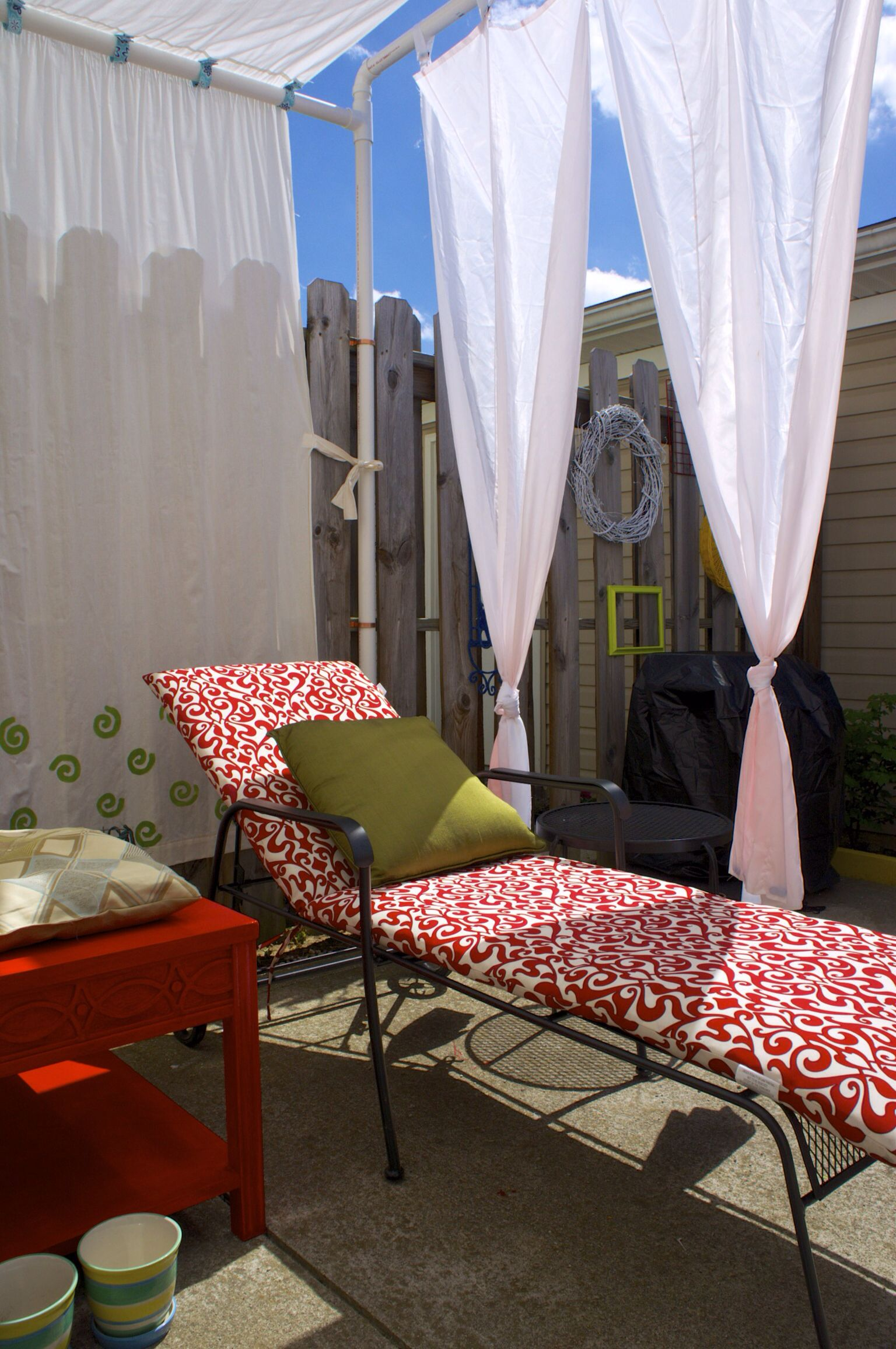 Repainted the side table (from Goodwill) in red. A DIY canopy using PVC pipes with white curtains (muslin fabric). The green pillow is made ... & Amazing Outdoor Canopy Curtains Pics Decoration Ideas ...