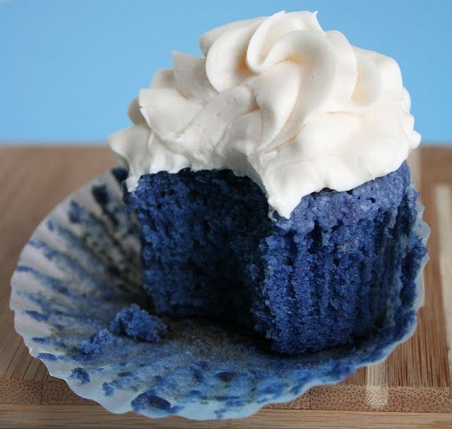 Blue Velvet cupcakes! ....with a strawberry on top for the 4th