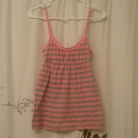 Small Hollister Pink & Grey Striped Cami This Hollister size small cami has been worn, but it is in good condition with no flaws. It also has adjustable shoulder straps. I will be glad to bundle! Hollister Tops Camisoles