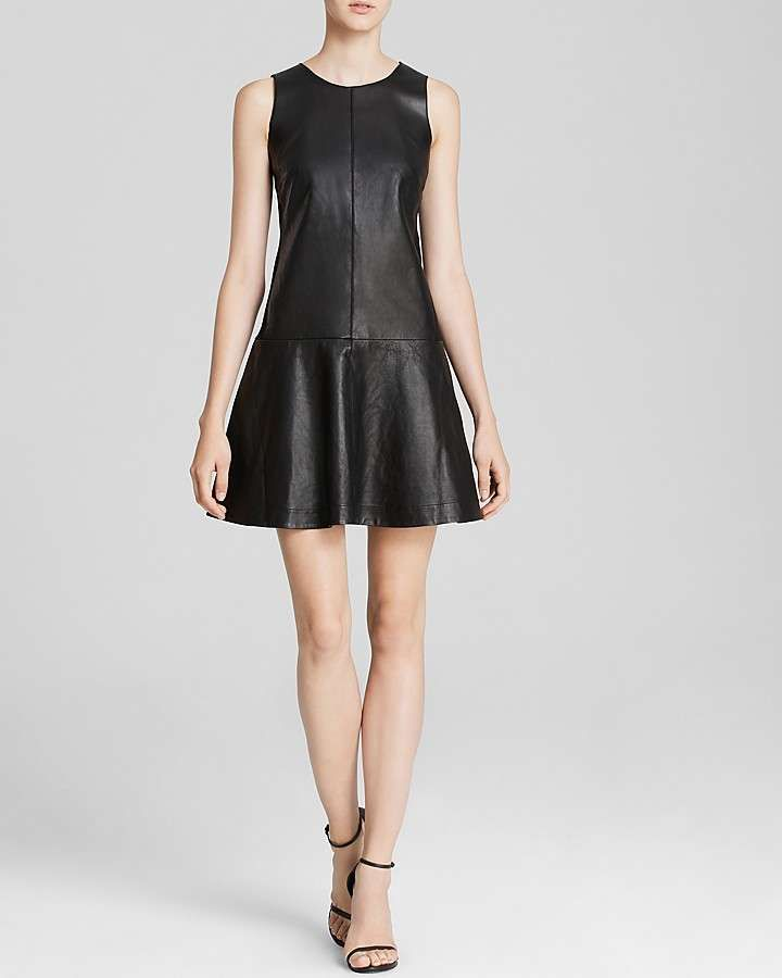 Flaunt a sleek silhouette in luxe black leather. Dress by Rebecca Taylor.Lamb leather; combo: viscose/nylon/spandex; lining: polyesterDry cleanImportedRound neck, sleeveless, leather front and skirtFabric back bodice, concealed zip back closure, lined