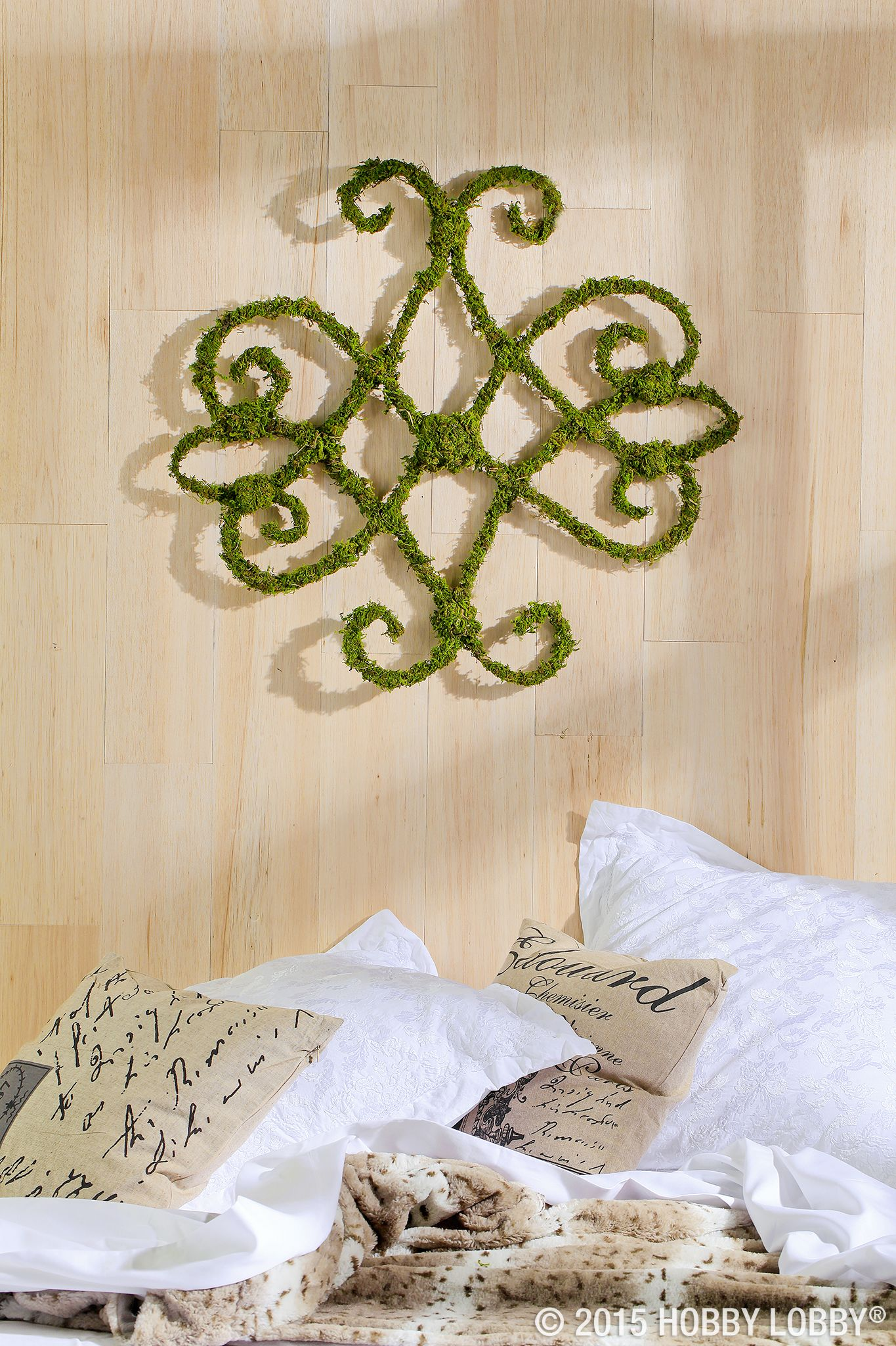 We used wired moss vine to make this gorgeous wall décor we simply