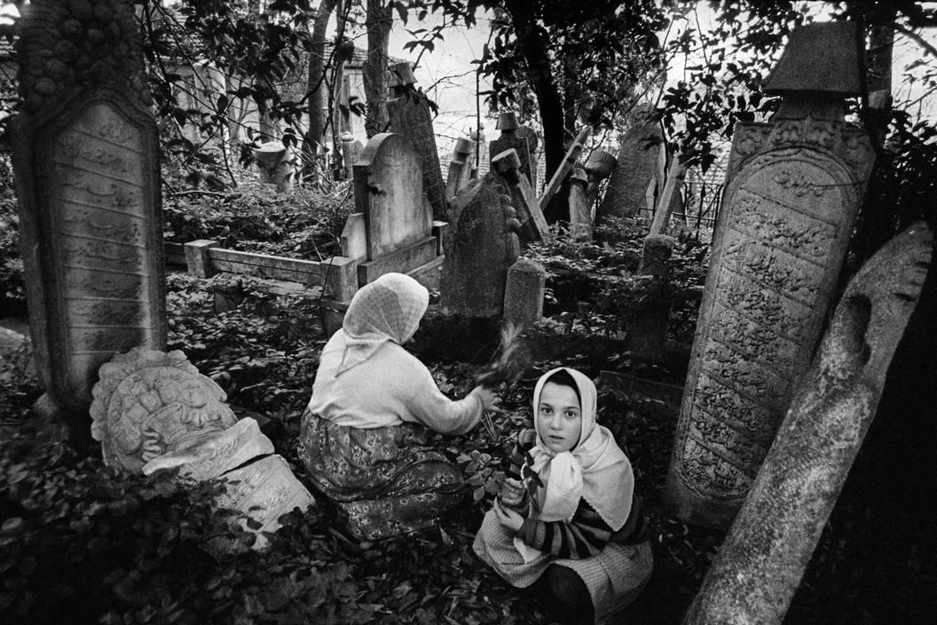 Turkey 1985, Children playing among the tombstones in the Seyhulislam Yahya Efendi cemetary at Ortakoy, photo by Ara Güler (please repin with photographers credits)