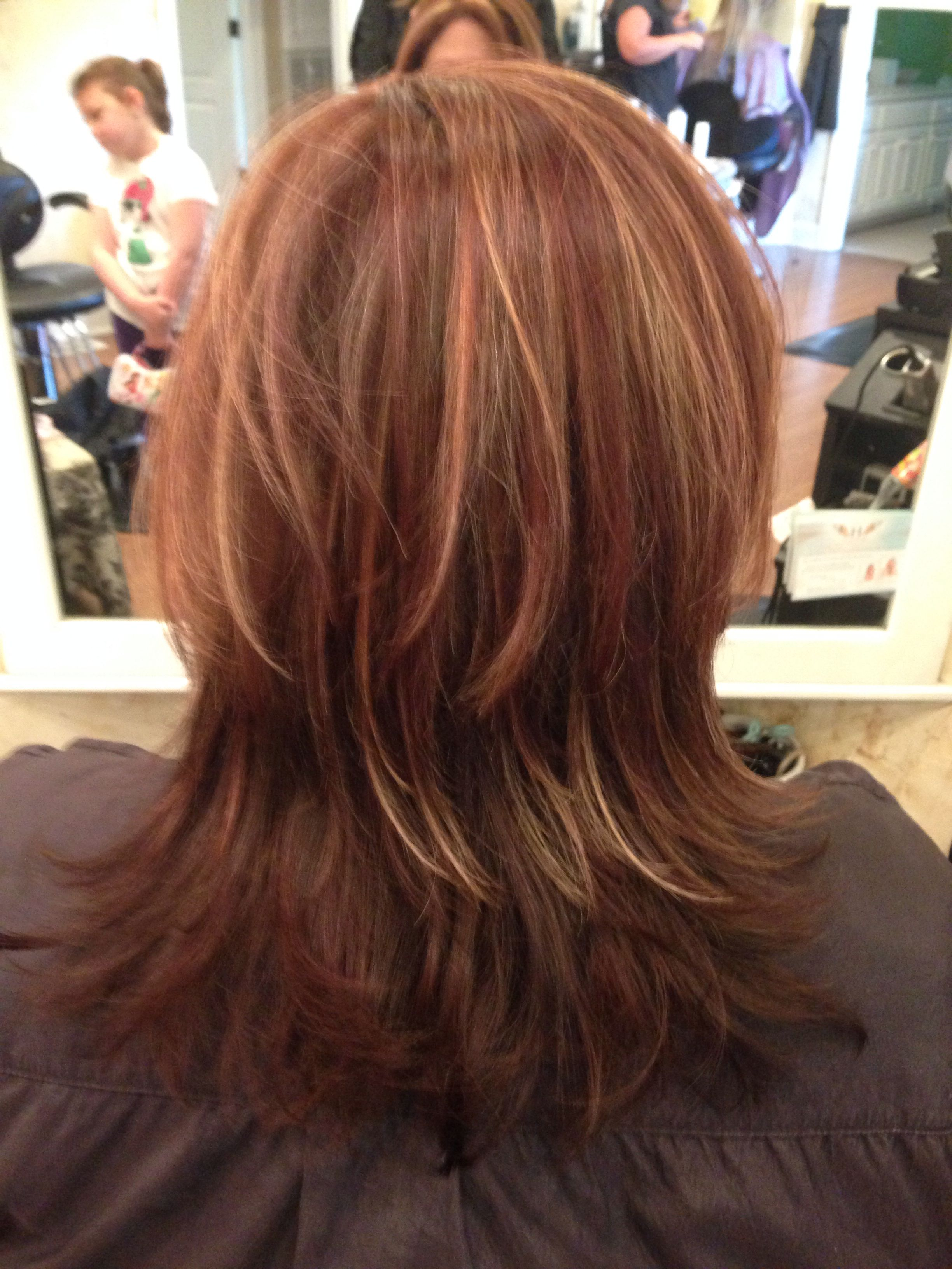 Layers and warm blonde highlights with racing red and chocolate