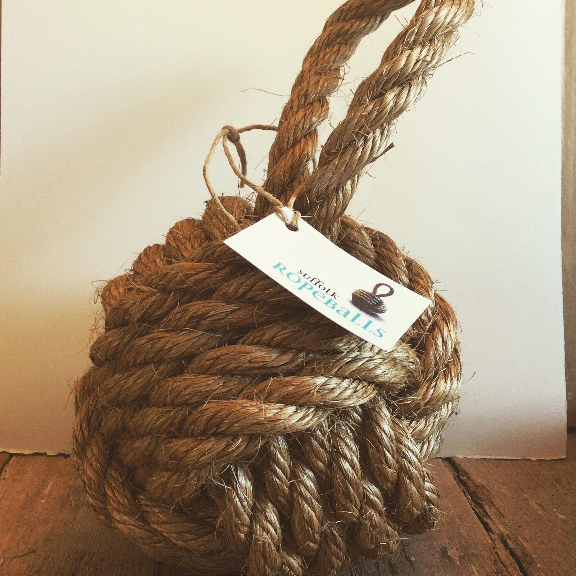 Premium weighted rope ball door stop. Perfect for home decoration for those seeking a nautical or rustic theme.   Created and manufactured by hand in England using high quality manila rope. Suffolk Rope ball door stops make fantastic additions to any home, particularly those seeking a nautical theme. #HomeDécor	#nauticaldecor #ropedoorstop #nauticaldoorstop #nauticalrope #rope	#beachdecor #nauticaldecoration #interiorinspiration #interiordesign