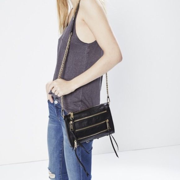 Rebecca Minkoff Mini 5-Zip Crossbody Authentic black leather Rebecca  Minkoff Crossbody. Black with gold hardware. Comes with extra tassels and  dust bag. 65fa38c15e0