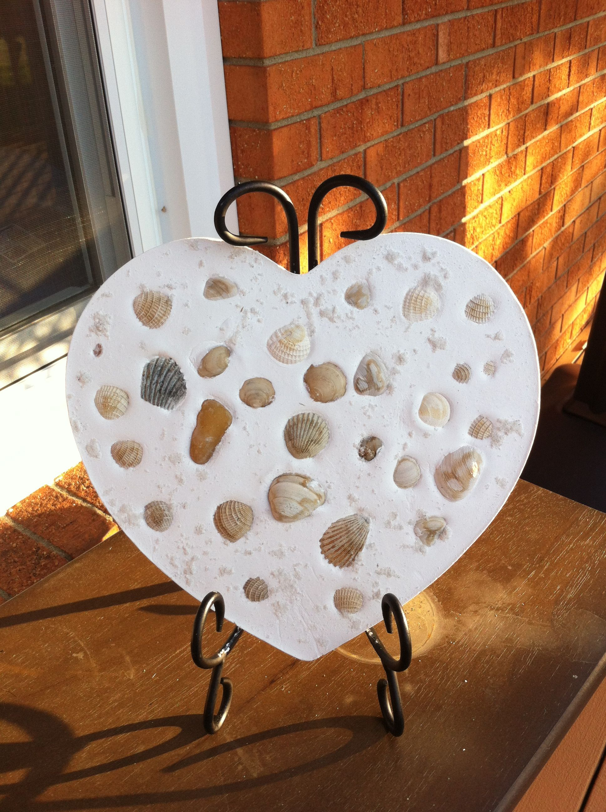 Plaster of Paris and heart mold from Walmart. Me and my daughter made this stepping stone and placed shells and white sand from our beach vacation in the plaster while still wet. Let dry for 24 hrs, and now have a neat way to show off our sand treasures :)
