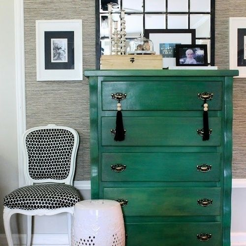 A green dresser and black accents. Something about the tassels too.
