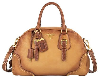 e83cd9d8ef86 Kate's now vintage Prada bowler bag is a deeper caramel than pictured. The  bag's defining features are the rounded silhouette, rolled handles, ...