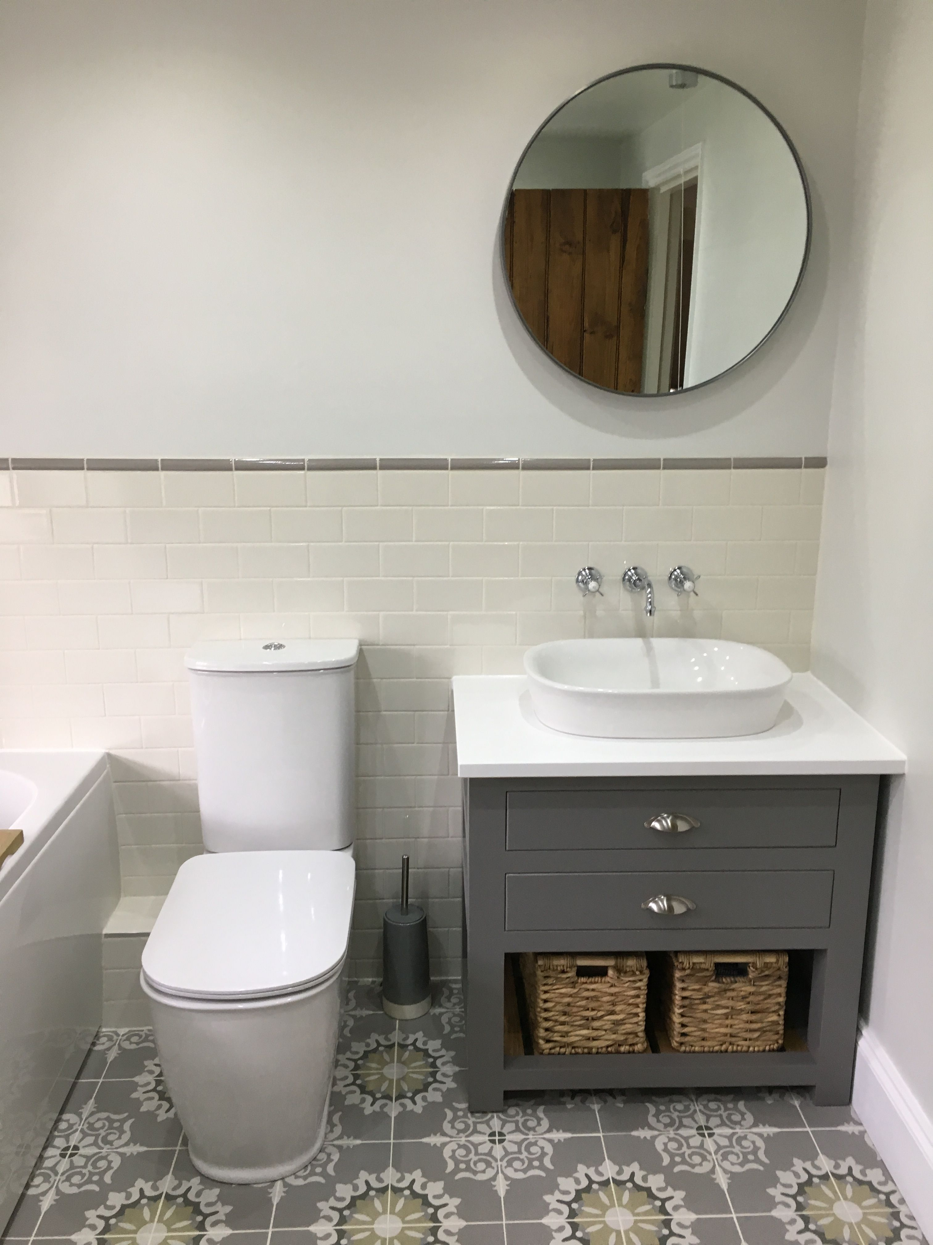 Fired earth tiles and taps, pura liberty toilet and basin. Parker