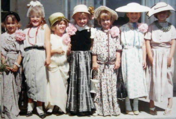 Little Girls playing dress up.