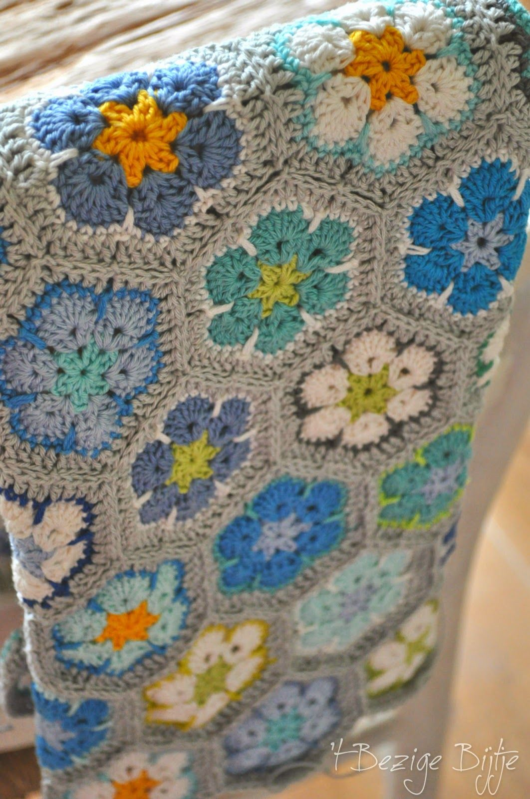 African Flower crochet blanket - love the colours, especially the white flower with blue border.