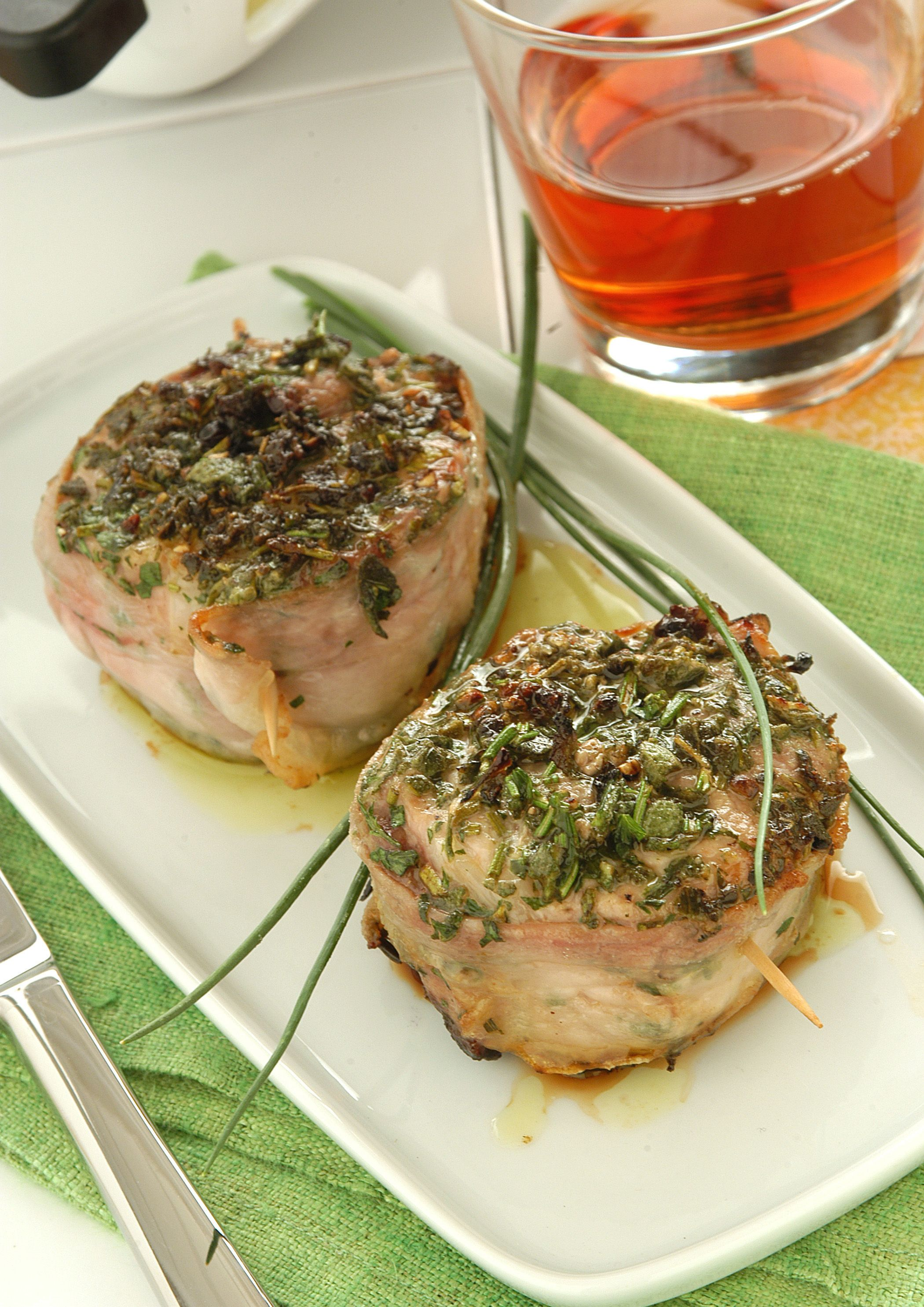 Photo of The pork tenderloin is wrapped in crispy lard and with the …