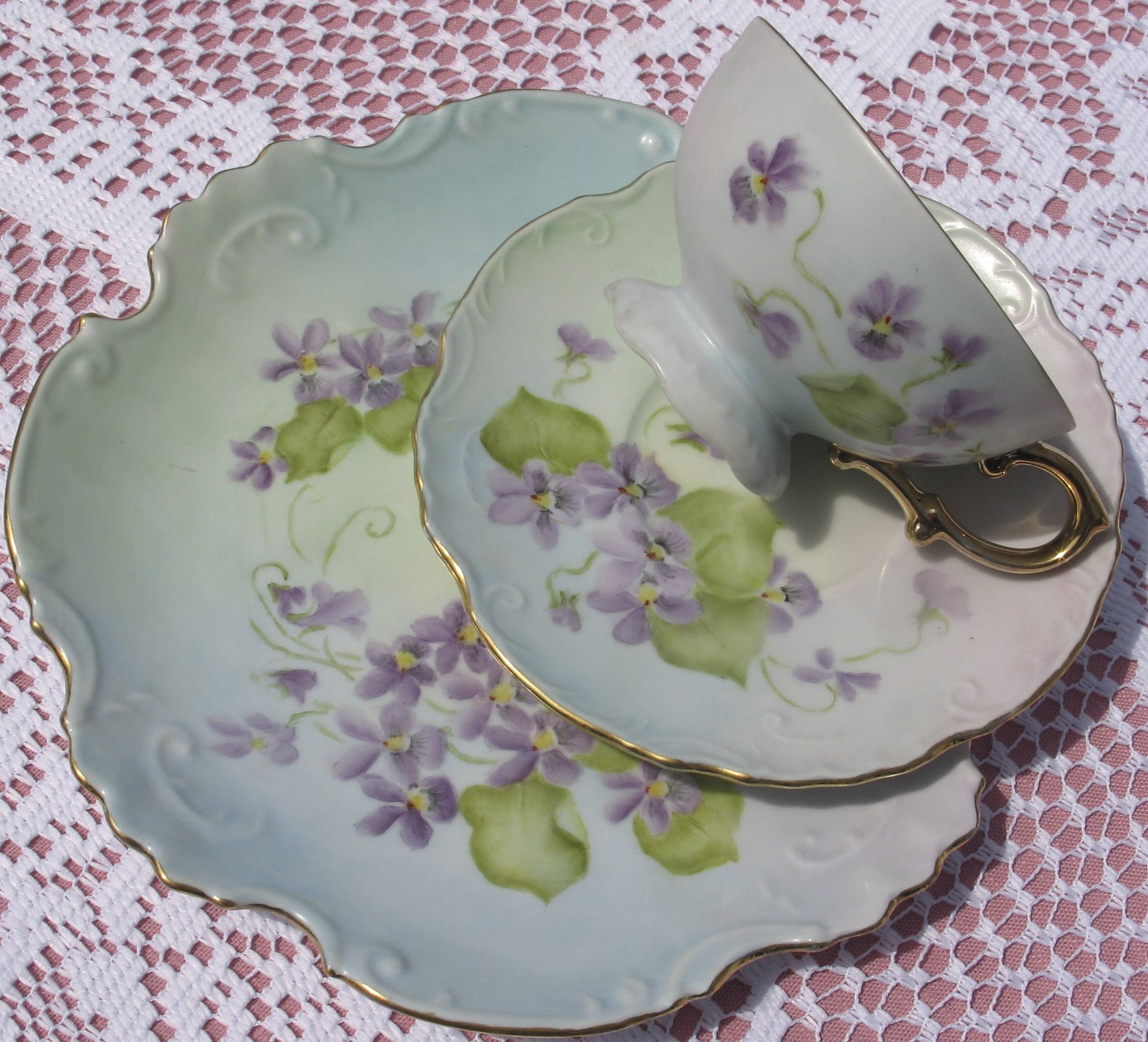 One trio in a group of 5 different floral patterns.  This is the violets hand painted set.  Love the wavy plate edge.  Available for rent with the group or without.
