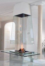 Free standing glass enclosed fireplace. Stunning to say the least ...