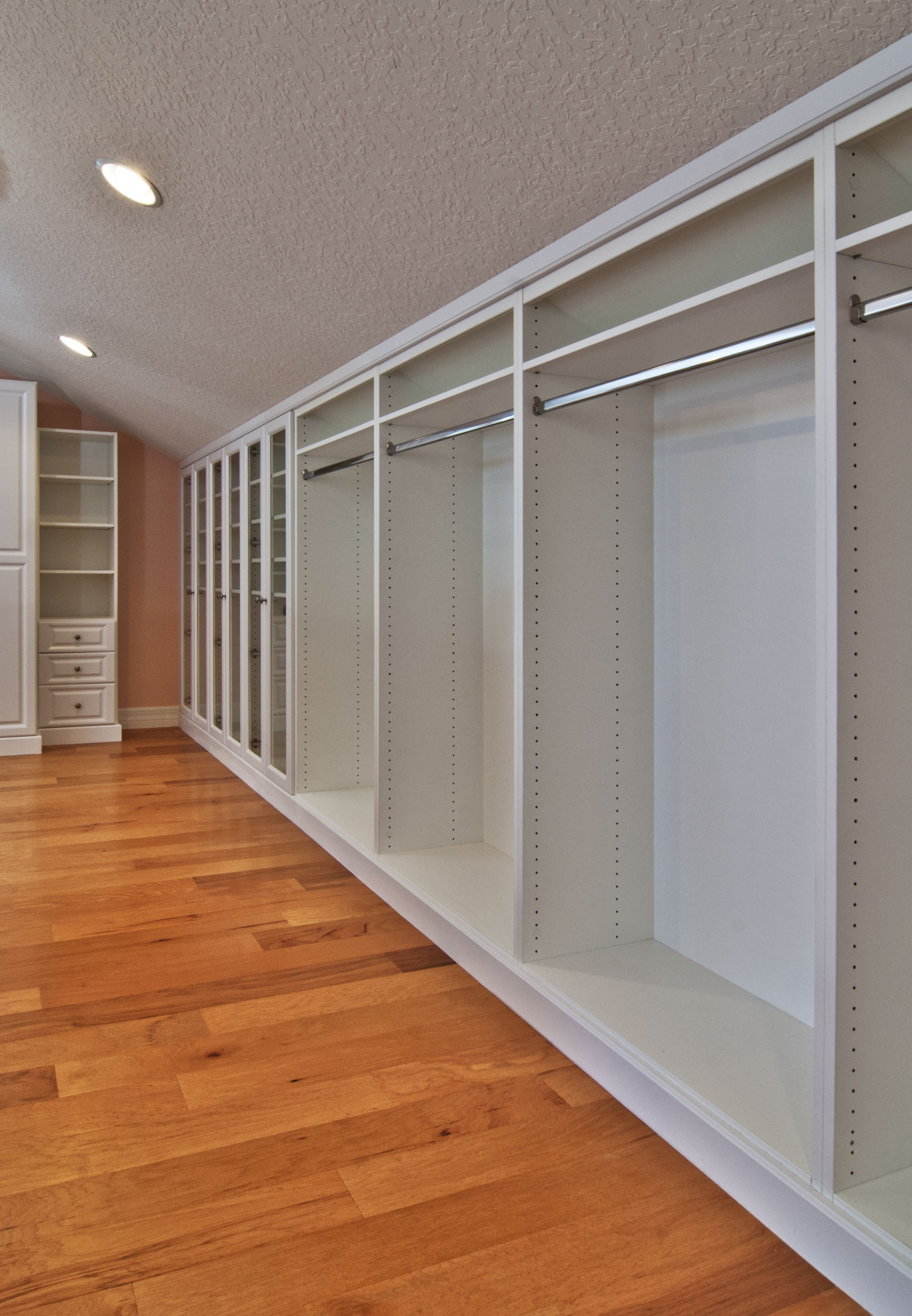 Master Closet White Inside Finished Attic With Angled Ceilings
