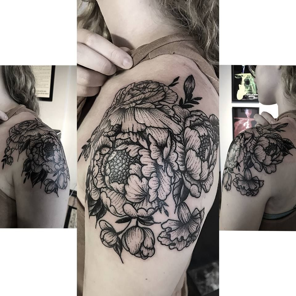 Beautiful floral shoulder cap tattoo done in the stipple