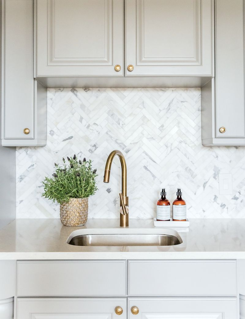 Benjamin moore chelsea gray cabinets and marble herringbone kitchen backsplash studio mcgee photo by lindsay salazar