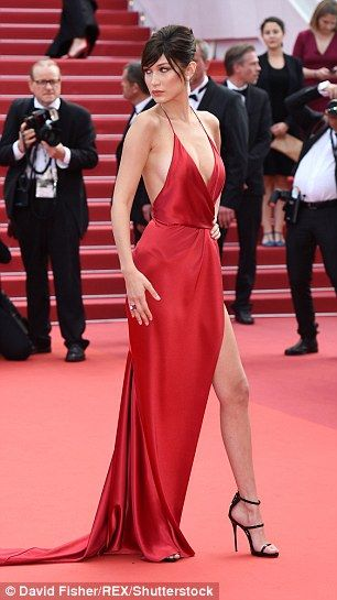 af82367c8d16 'It was a big risk': With its plunging neckline and thigh-high split, Bella's  gown marked a dramatic departure from her usual look
