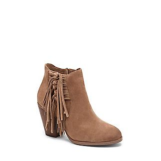 """VINCE CAMUTO HARLIN- TASSEL STACKED HEEL BOOTIE-In a bootie showdown this Western shoe brings a style advantage. A luxe addition to ruffled maxi dresses and crochet vests, the Harlin is an instant outfit complement in genuine leather or suede with an earthy stacked heel. On the side it is adorned with twisted panes of leather knotted into two tassels for an of-the-moment fringe effect.  <li> 3.5"""" heel <li> 5.5"""" shaft height <li> Leather upper, man-made lining and sole <li> Side zip closu..."""