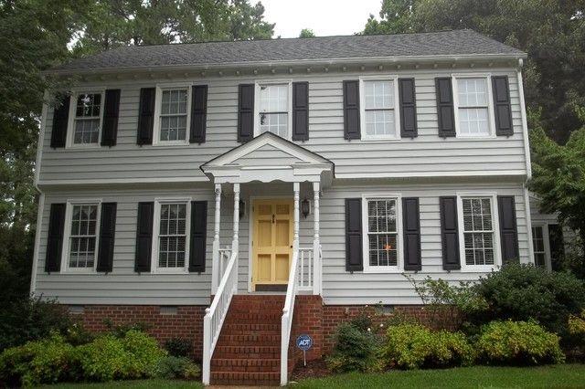 Grey House Black Shutters Yellow Door With Bricks House Shutters Black Shutters House Exterior