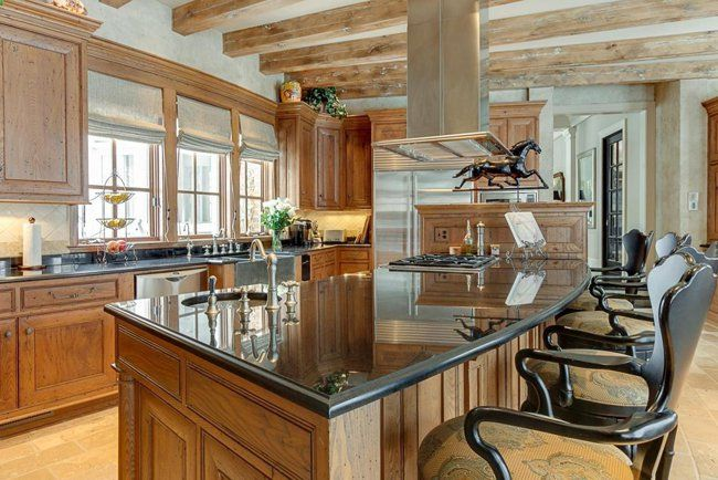 Black counter tops make an immediately statement in this