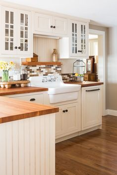 Farmhouse Sink The Rising Kitchen Icon Cottage Kitchen Cabinets