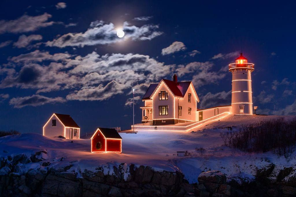 Nubble Lighthouse with moonlight and Christmas lights. York, Maine ...