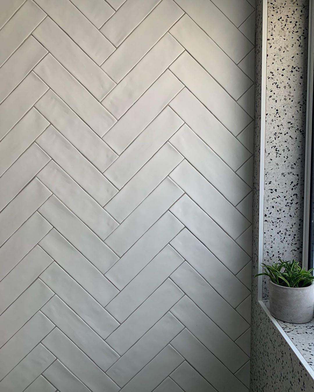 Tilecloud On Instagram Matt White Herringbone In New Classic Who Is Planning On Doing It White Herringbone Tile Herringbone Tile Bathroom Herringbone Tile